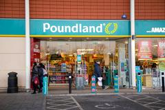 LONDON - JANUARY 23rd: The exterior of Poundland  on January the 23rd, 2015,  Stock Photos