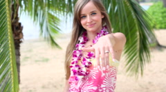 Girl wearing flower Lei and Showing engagement ring. Wedding concept on Hawaii.  - stock footage