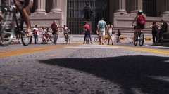 Many go by the camera on this busy pedestrian walkway. Stock Footage