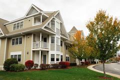 apartment building in autumn season - stock photo