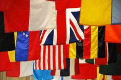 Hanging flags of multi nations Stock Photos