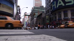 A crosswalk view of a busy intersection in New York City Times Square. Stock Footage
