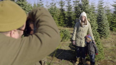 Father Photographs His Family At Christmas Tree Farm, With Digital Camera Stock Footage