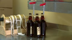 Bottle of maple syrup being filled. Tilt Stock Footage