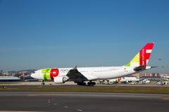 LISBON, PORTUGAL- January 9th, 2015: A Tap Portugal flight in Lisbon on the 9 Stock Photos