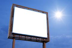 Blank billboard for advertisement on beautiful sky background Stock Photos