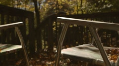 Lawn chair in fall. - stock footage