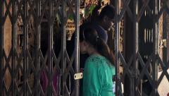 Hindu pilgrims enter the Hadimba temple side shot Stock Footage