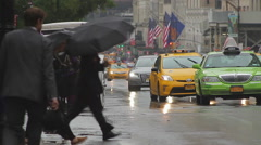 59th Street, rainy day, horse and carriage, cabs, people Stock Footage