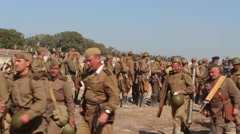 Tired and Happy Russian soldiers marching along the dusty road Stock Footage