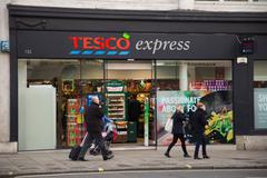 LONDON - DECEMBER 11TH: The exterior of an Tesco's express supermarket on Dec Stock Photos