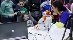 4k Science fair.Children communicate with inteligent robot,Android Stock Footage
