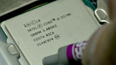 Applying Thermal Compound to Intel I5 CPU Stock Footage