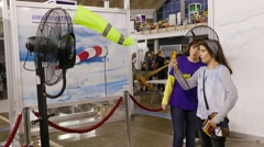 4k Science fair.Children use robotics devices to measure wind power green energy Stock Footage
