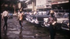 2949 - Jamaican street scene on rainy day - vintage film home movie Stock Footage