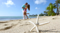 Engagement ring on the starfish beach love concept - stock footage