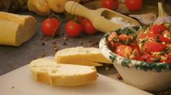 Seasoning italian bruschetta with tomatoes Stock Footage