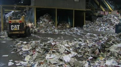 Pile of sorted paper in an Ottawa Recycling Plant. Tilt - stock footage