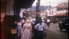 2951 - tourist walk Jamaican streets on sunny day - vintage film home movie Stock Footage