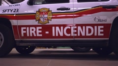 Emergency fire vehicle parked inside the garage of a fire station. - stock footage