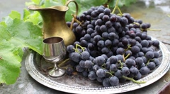 Silver salver with grapes and beautiful metal utensils Stock Footage