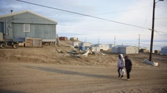 People walking through the streets of Pond Inlet. Stock Footage