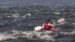 Kayaker in Gatineau rapids. Pan Stock Footage