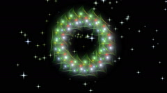 Radiant Christmas wreath, red, green, white and golden with twinkling stars - stock footage