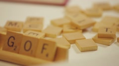 Pan shot of a Scrabble pieces and letter stands. Stock Footage
