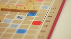 Pan shot of a Scrabble board with words. - stock footage