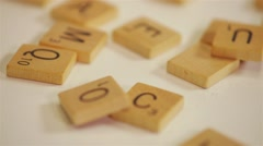 Close up pan shot of a Scrabble board, pieces, and letter stands. Stock Footage
