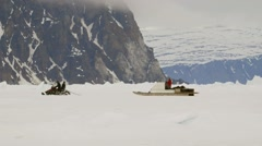 Qamutiq being towed across an Arctic ice field. Stock Footage