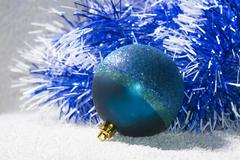 New years ball with blue and white tinsel. Backround Christmas theme Stock Photos