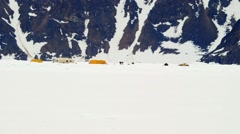 An Arctic expedition campsite beneath a mountain range. Stock Footage