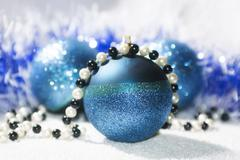 Stock Photo of New years ball with blue and white tinsel. Backround Christmas theme