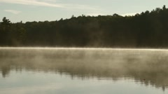 Steam settling on a lake as dusk approaches. - stock footage