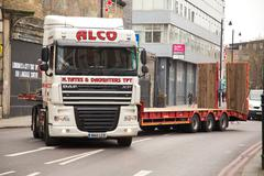 LONDON - NOVEMBER 25TH: A long alco truck navigates a sharp corner on Novembe - stock photo