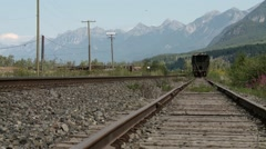 A tanker train car beneath the Bugaboo Mountains. Stock Footage
