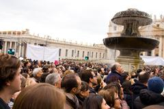LONDON - JANUARY 26TH: Unidentified people gather in st peters square to see  - stock photo