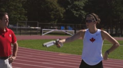 Woman trains for a pentathlon by practicing shooting a laser pistol. Stock Footage