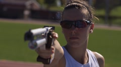 Woman training for a pentathlon aims before shooting a laser pistol. Stock Footage