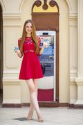 Blonde lady using an automated teller machine Stock Photos