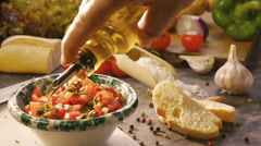 Tasting chopped tomatoes Stock Footage