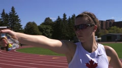 Woman practicing shooting a laser pistol while training for a pentathlon. Stock Footage