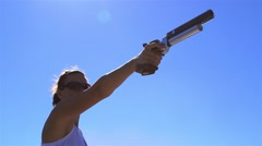Woman practices shooting a laser pistol while training for a pentathlon. Stock Footage