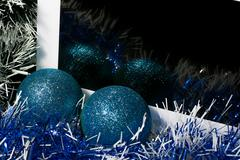 New year theme. Tablet pc on tinsel background with color sphere - stock photo