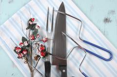 Christmas roast turkey carving utensils set with pale blue and white stripe a Stock Photos