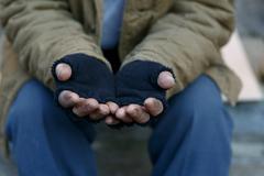 Homeless man asking for help Stock Photos