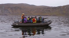Tourists on a zodiac boat tour during an expedition. Slow Motion - stock footage