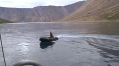 Man driving zodiac boat in Torngat Mountains. Stock Footage